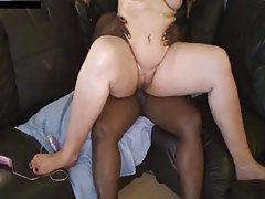 Fat chick sits on black dick on couch tubes