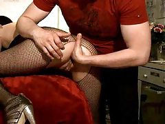 She wears fishnets and he fists her tubes