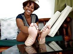 Black chick showing us her feet tubes