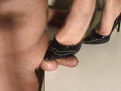 She steps on his cock with heels tubes