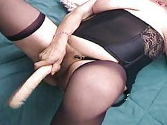 Old lady using toy and then his cock tubes