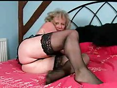 Granny in stockings lubes up and masturbates tubes