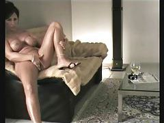 Naked chick watches TV and masturbates tubes
