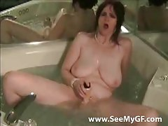 Chick fucks a dildo in the bathtub tubes