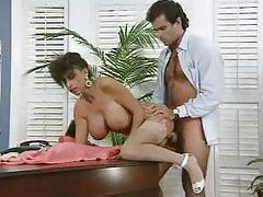 Horny boss fucks his big titted secretary tubes