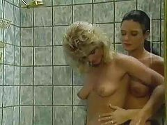 Two natural girls have lesbian sex in the shower tubes