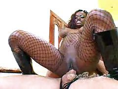 Black slut in fishnets for cock and cum tubes