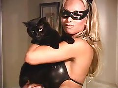 Blonde as Catwoman in skintight black leather tubes