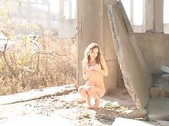 Stunning teen girl stripping outdoors tubes