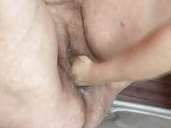 Fat old slut has her pussy fisted tubes