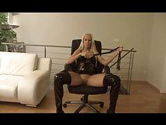 Chatty German girl in latex using a toy tubes
