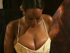 Black girl in ball gown plays with big tits tube