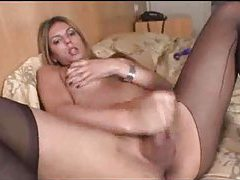 Busty tranny in pantyhose masturbates tubes