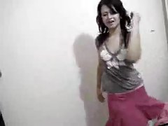 Honey in skirt dances on her webcam tubes