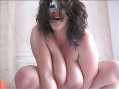 Masked fat girl plays with big toy tubes