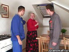 Busty granny lets handymen have her tubes