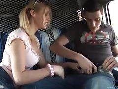 Pigtailed girl giving handjob in car tubes