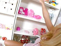 Blonde trying huge electric toy tubes