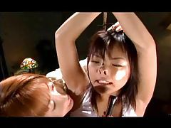 Cute Japanese girl is put into bondage fun tubes