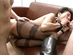 Mature in boots and stockings takes two tubes