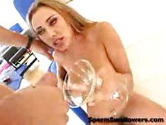 Blonde girl drinks a martini glass of cum tubes