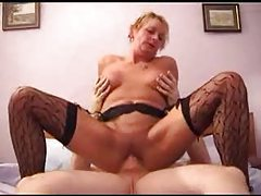 Mature blonde lady sitting on a cock tubes