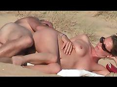Couple fucking and fingering at the beach tubes