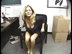 Amber Michaels gobbling cock in office tube