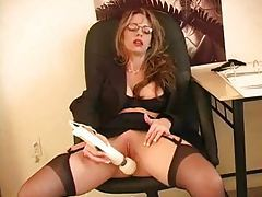 Corporate chick with big tits using toy tubes