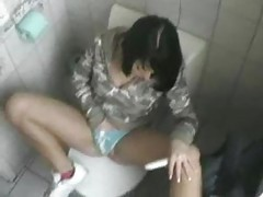 She masturbates while on the toilet tubes