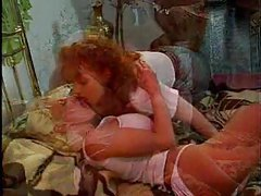 Redhead wears strapon for blonde tubes