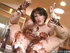 Naked skinny chick covered in chocolate sauce tubes