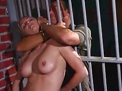 Stud fucks a slut in a jail cell tubes