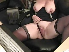 Mature in nipple clamps at her desk tubes