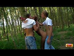 Guys double teaming a teen outdoors tubes