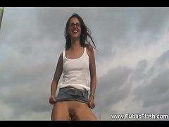 Girl in glasses on a dock showing nakedness tubes