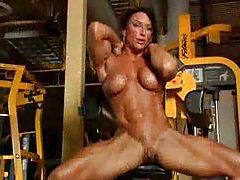 Naked body building babe in the gym tubes
