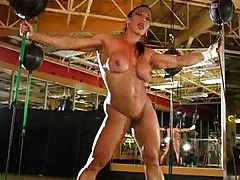 Incredibly muscular girl strips in boxing gym tubes