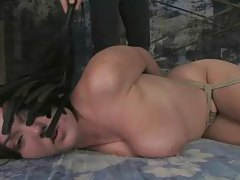 Busty sexy biatch tied with hands behind gets fucked in the mouth and from behind tubes