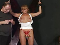 Mature woman suffers pain in BDSM scene tubes