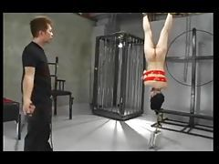 Girl in bondage is whipped hard tubes