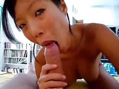 Pretty Asian sits on a big cock in POV tubes