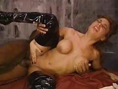 Girl in shiny boots goes for black cock tubes