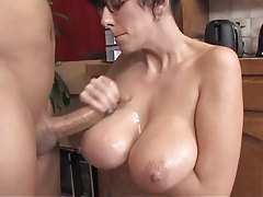 Nerdy babe in glasses gets tit fucked tubes