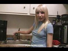 Cute blonde teen masturbates in sink tubes