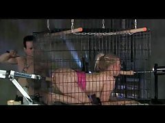 Blonde in a cage fucked by dildo machine tubes