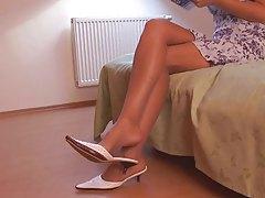 Nylon fetish model showing her sexy feet tubes