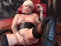 Mature German in boots toys her cunt tubes