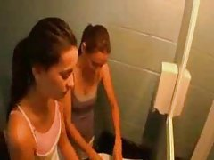 Two hot and slender girls go lesbian in gym tubes