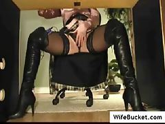 Babe in leather boots using a toy tubes